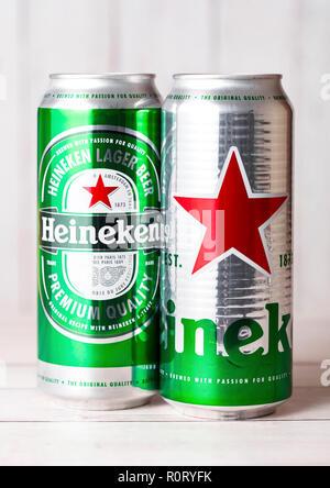 LONDON, UK - APRIL 27, 2018: Aluminium cans of Heineken Lager Beer on wooden background. Heineken is the flagship product of Heineken International - Stock Photo