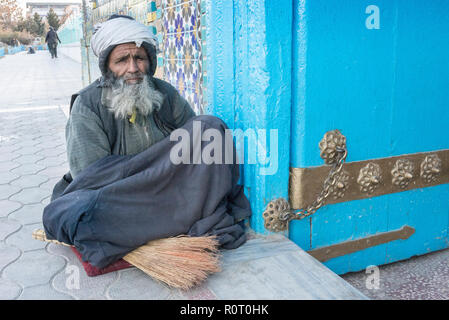 Sweeper At The Entrance Of The Shrine Of Hazrat Ali, also called the Blue Mosque, Mazar-e Sharif, Afghanistan - Stock Photo