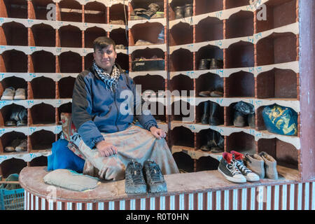 Shoe Keeper At The Entrance Of The Shrine Of Hazrat Ali, also called the Blue Mosque, Mazar-e Sharif, Afghanistan - Stock Photo