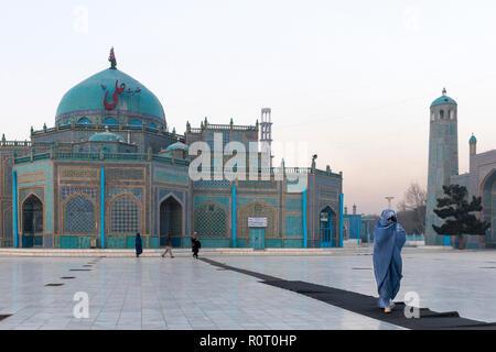 Female Pilgrim Walking Towards The Shrine Of Hazrat Ali, also called the Blue Mosque, Mazar-e Sharif, Afghanistan - Stock Photo