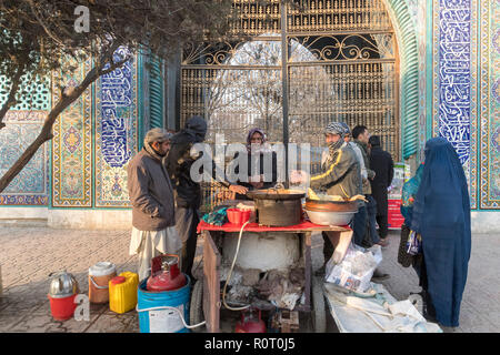 Men Selling Food Outside The Shrine Of Hazrat Ali, also called the Blue Mosque, Mazar-e Sharif, Afghanistan - Stock Photo