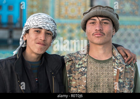 Two Young Pilgrims At The Shrine Of Hazrat Ali, also called the Blue Mosque, Mazar-e Sharif, Afghanistan - Stock Photo
