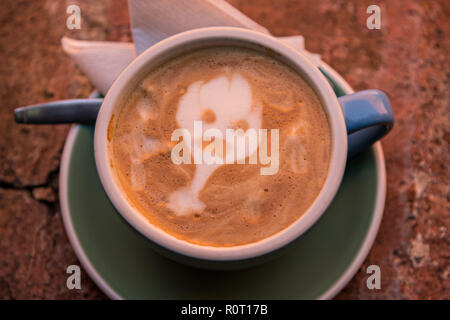 A cafe latte with a ghost design made from the foamed milk during the Dia de Muertos festival in San Miguel de Allende, Mexico. - Stock Photo