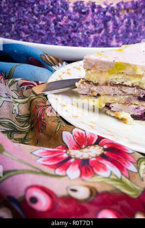 A piece of blueberry layer cake on a white plate, sweet dessert for tea time or coffee break, holiday cake - Stock Photo