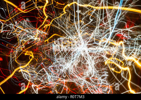 Slow shutter speeds creating abstract lighting trails of cars on the motorway, roads, highway taken on a DSLR camera - Stock Photo