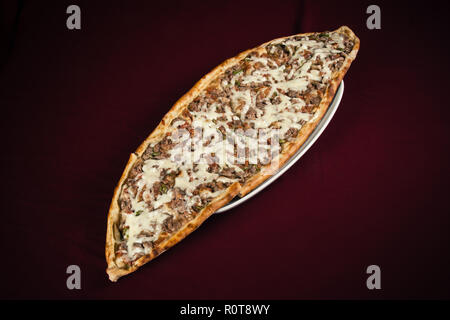 Turkish pita bread with chopped meat and cheddar cheese - Stock Photo