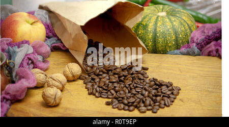 Coffee beans in paper bag autumn context - Stock Photo