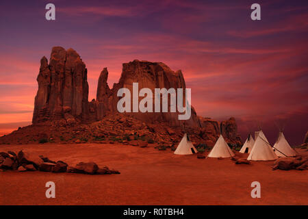 Wigwams/tepees of native Americans in Monument Valley at sunset, Arizona-Utah border, USA - Stock Photo