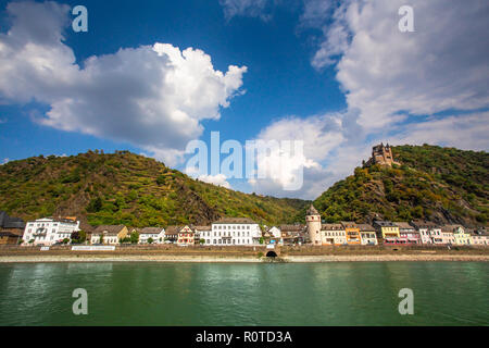 View along the beautiful Rhine River in Germany with the Village of Sankt Goar in view - Stock Photo