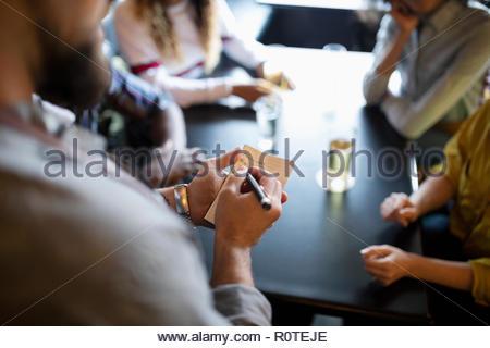 Waiter taking order in bar - Stock Photo