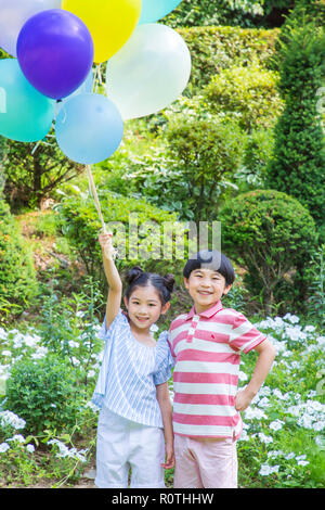 Cute little boy and girl harvesting together. Gardening, planting concept photo 300 - Stock Photo