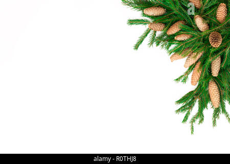 Christmas frame composition with gift box, pine cones, fir tree branches, isolated. Flat lay, top view, copy space - Stock Photo