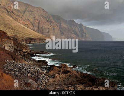 Sea cliffs at Punta de Teno on the Atlantic coast of Tenerife in the Canary Islands - Stock Photo
