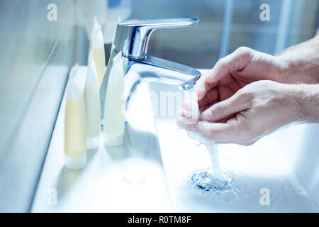 Mature businessman enjoying his morning routine in the bathroom - Stock Photo
