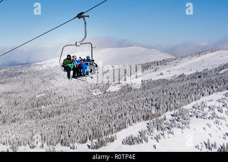 Kopaonik, Serbia - January 22, 2016: Skiers arriving to the station on the ski lift - Stock Photo