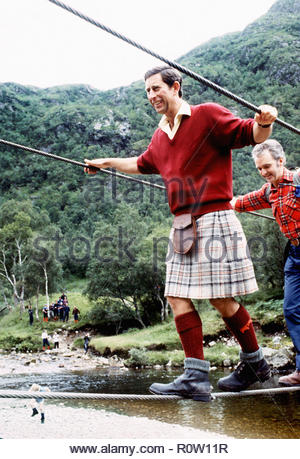 File photo dated 18/08/87 of the Prince of Wales negotiating a 2 inch wide wire bridge during a trek in the foothills of Ben Nevis with the Lochaber Mountain Rescue Team. - Stock Photo
