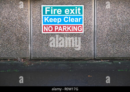 Fire exit keep clear no parking sign - Stock Photo