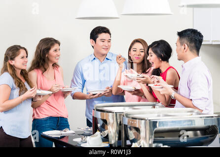 Friends enjoying the dinner at a party - Stock Photo