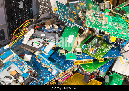 E-waste pile from discarded laptop parts. Connectors, PCB, notebook keyboards. Colorful background from PC components. Recycling of electronic waste. - Stock Photo