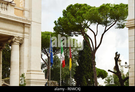 The national flag of Italy, the European Union EU flag of the city of Rome on the flagpole near the city Hall of Rome, on 7 October 2018 - Stock Photo