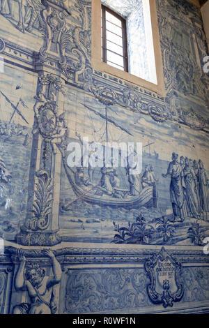Azulejo tiles depicting scene from the bible on interior wall of the Igreja de Sao Pedro de Palmela - Stock Photo