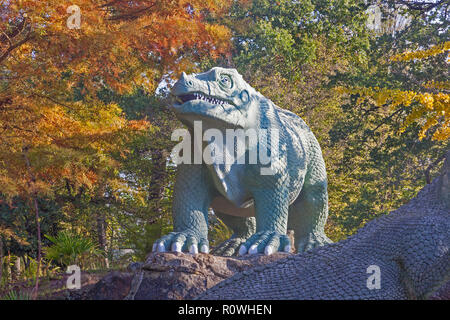 A life-size model of a Megalosaurus in The Dinosaur Court at Crystal Palace Park in South East London. - Stock Photo