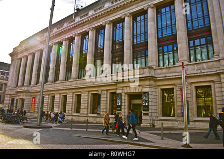 People strolling past the main entrance to the famous Science Museum in Kensington, London, England, UK - Stock Photo