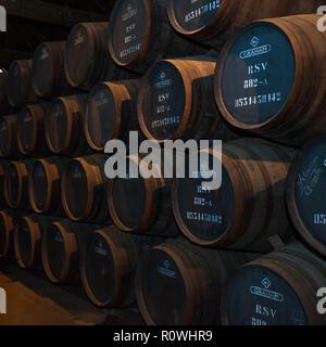 PORTO, PORTUGAL - April 2, 2014: Port wine barrels in Graham's port lodge, Vila Nova de Gaia, Porto, Portugal - Stock Photo