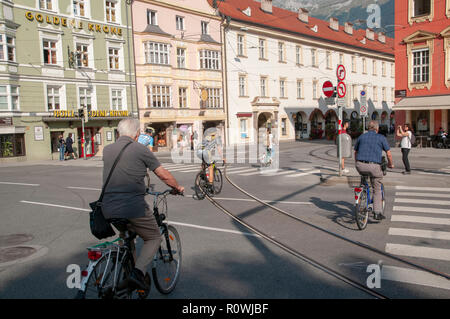 Cycling in downtown Innsbruck, Tyrol, Austria - Stock Photo