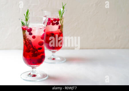 Cranberry Cocktail with Ice and Rosemary On White Background, Refreshing Drink - Stock Photo