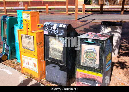 Newspaper vending machines on the sidewalk in downtown Santa Fe, New Mexico USA - Stock Photo