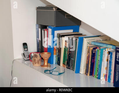 Bookshelf in a medical professional's consulting room - Stock Photo