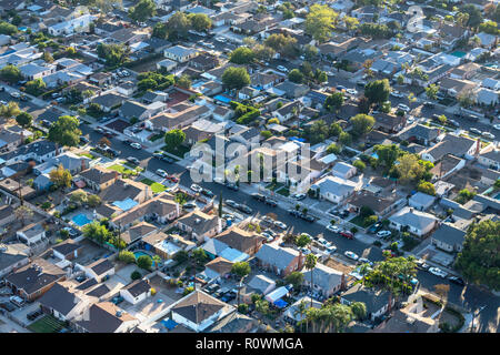 Late afternoon aerial view older San Fernando Valley residential streets and homes near Van Nuys in Los Angeles, California. - Stock Photo
