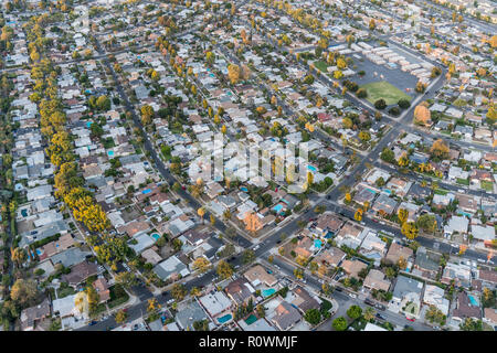 Late afternoon aerial view of houses and streets in the San Fernando Valley region of Los Angeles, California. - Stock Photo