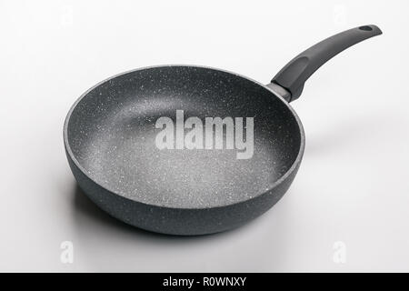 Stone Frying Pan Isolated on White Background. Angle View. - Stock Photo