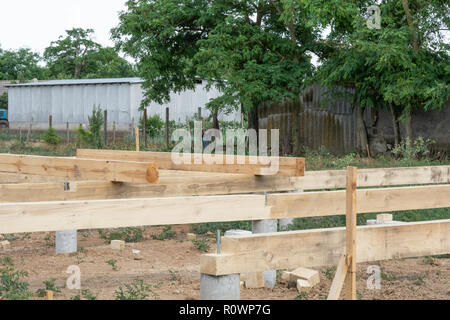 The timber framing of a A-type house under construction on a pile foundation. Pile foundation construction frame house. - Stock Photo
