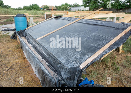 A box-platform for the impregnation of pine boards with an antiseptic protective agent against insects and fire. Construction of the frame house. - Stock Photo