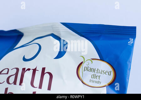 Close up of bag of Earth Balance vegan cheese puffs, emphasizing 'plant-based diet' on label. - Stock Photo