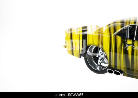 Rear view of a muscle diecast car double exposured with autumn forest image on isolated white background - Stock Photo