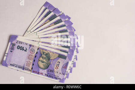 All new 100 Rupees Indian Currencies on islolated background - Stock Photo