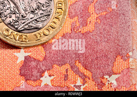 British £1 coin on a 10 Euro note - Stock Photo