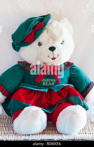 Grandma Bear teddy bear soft cuddly toy by DanDee sitting on wicker basket - one of Grandparents Limited Edition teddies (for Grandpa Bear see PXY0A4) - Stock Photo