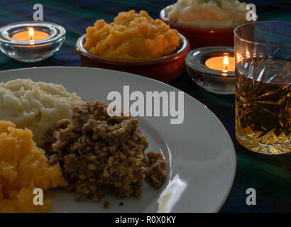 Burns Supper, haggis with neeps and tatties and a wee dram of Scotch Whiskey - Stock Photo