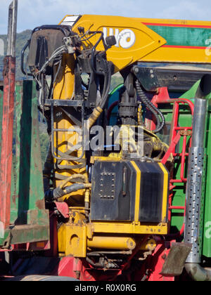 Hydraulic Lifting Gear Grab on a Timber or Lumber Lorry or Truck - Stock Photo