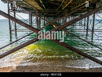 east sussex  Brighton Pier seen from underneath - Stock Photo