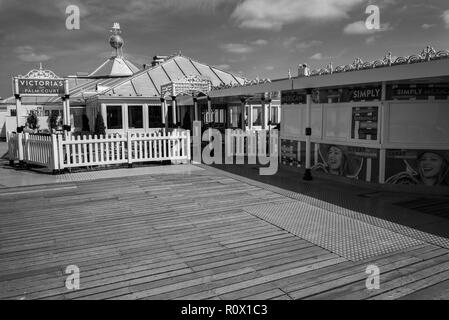 victoria's palm court bar and restaurant on Brighton Palace pier Sussex UK - Stock Photo