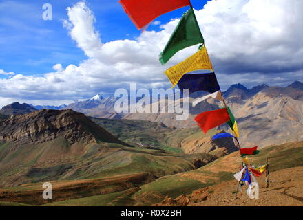 Prayer flags flutter high on the Balari top at 5000m ASL - Stock Photo