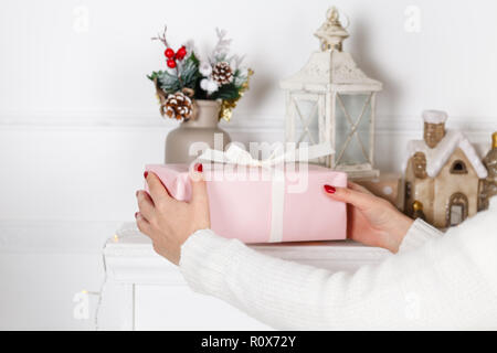 Christmas Time gifts - gift box in hand girls - Stock Photo