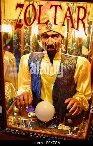 Close-up of animatronic fortune-telling machine, after receiving payment, makes a prediction 'Zoltar Speaks' from Zoltar, by Characters Unlimited. - Stock Photo