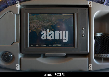 Flight map displayed on a video monitor on the seat of an aircraft Airbus A330-300 of China Airlines CI-917, economy class, fly from Taiwan - Stock Photo